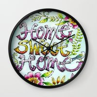 karen hallion Wall Clocks featuring Home Sweet Home - Karen Embry by Karen Embry