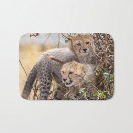 Cheetah cubs in a bush Bath Mat