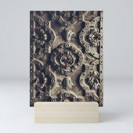 The iron door Mini Art Print