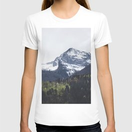 Winter and Spring - green trees and snowy mountains T-shirt