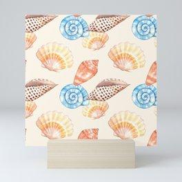 Colorful sea shells pattern on the sea shore Mini Art Print