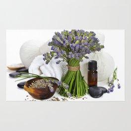 lavender spa (fresh lavender flowers, towel, essential oil, pebbles, Herbal massage balls) over whit Rug