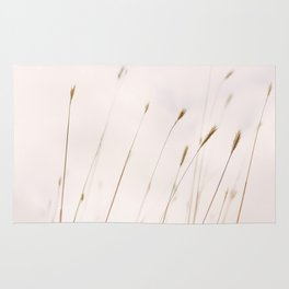 Tall grass against cloudy sky Rug