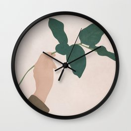 Holding the Branch Wall Clock