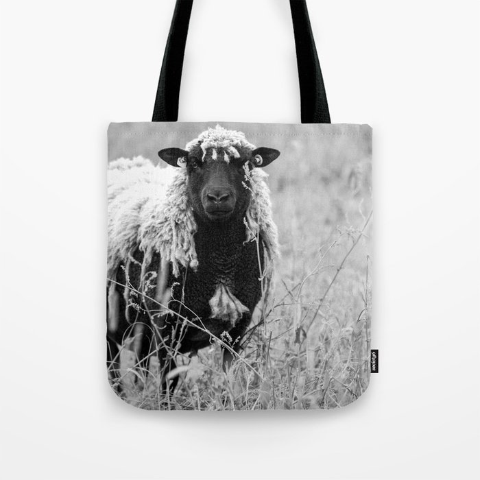 Sheep with sharp eyes Tote Bag