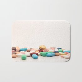Numerous medicines Medications in the form of tablets. Colored pills on a white background. Bath Mat