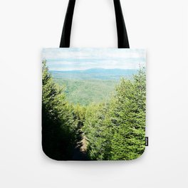 Between Trees and Mountains Tote Bag