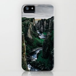 Fast flowing river making (wending) it's way between two massive rock formations iPhone Case