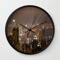 hong kong Wall Clocks featuring Hong Kong by Annie Lynch