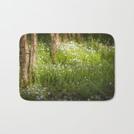 many white flowers in the forest Bath Mat