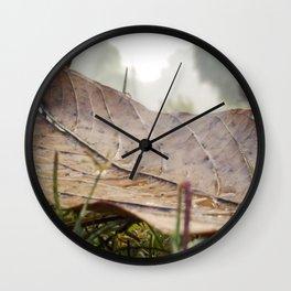 Dew drops on a fallen leaf Wall Clock