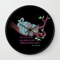 cheshire cat Wall Clocks featuring Cheshire cat by Pendientera