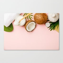 Coconut oil, tropical leaves and fresh coconuts Canvas Print