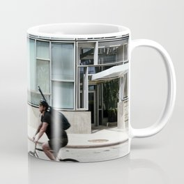 Cyclist riding in New York City Coffee Mug