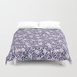 White flowers over a purple background Duvet Cover
