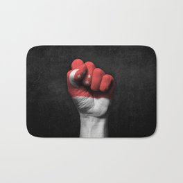Singapore Flag on a Raised Clenched Fist Bath Mat
