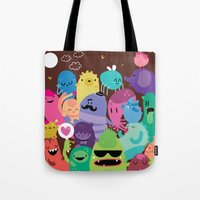 monsters Tote Bags featuring Monsters by Maria Jose Da Luz