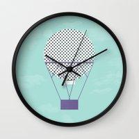 hot air balloon Wall Clocks featuring PURPLE HOT AIR BALLOON by Allyson Johnson