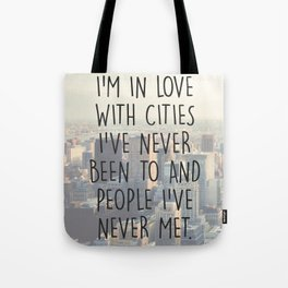 I'M IN LOVE WITH CITIES I'VE NEVER BEEN TO AND PEOPLE I'VE NEVER MET. Tote Bag