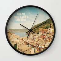 not all who wander are lost Wall Clocks featuring Not All Who Wander Are Lost by happeemonkee
