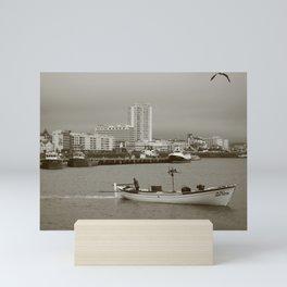 Small boat in the bay Mini Art Print