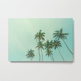 Tropical coconut palm trees on the ocean beach during sunset. Vintage stylized image. Metal Print