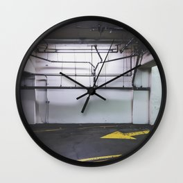 parking lot with the yellow arrow and tubes Wall Clock