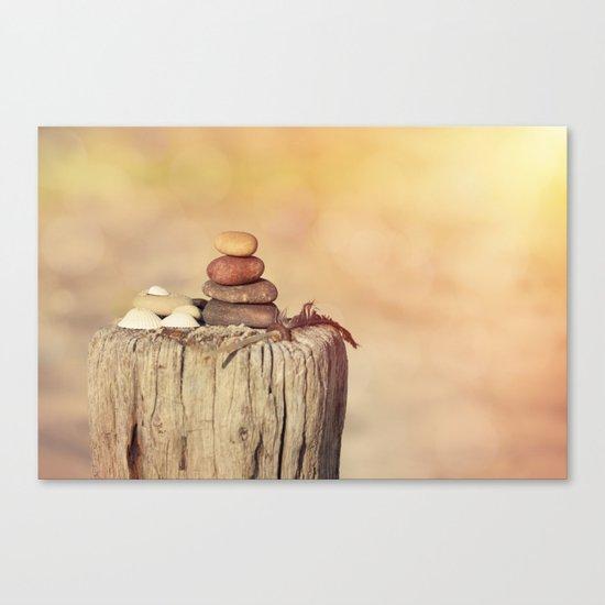 Balanced stone cairn in sunset light Canvas Print