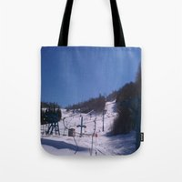 skiing Tote Bags featuring skiing place by westchestrian_art