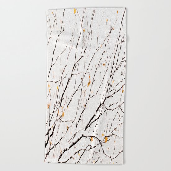 Snowy birch twigs and leaves Beach Towel