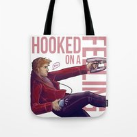 starlord Tote Bags featuring Hooked On a Feeling by Unbearable Bear