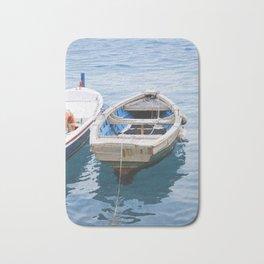 Little fishing boat, blue sea Bath Mat