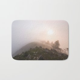 Magic atmosphere in the fog Bath Mat