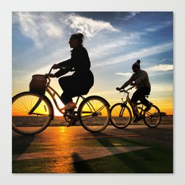 Cycling on sunset in Santa Monica, California, USA Canvas Print