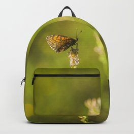 Butterfly on a wild flower Backpack