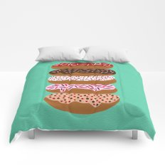 Stacked Donuts on Mint Comforters