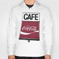 coca cola Hoodies featuring Coca-Cola Cafe by Vorona Photography