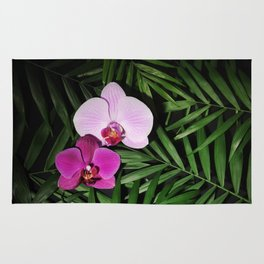 Orchids with palm leaves Rug