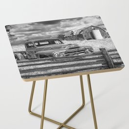 Black and White of Rusted International Harvester Pickup Truck behind wooden fence with Red Barn in Side Table