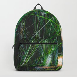 green grass field with grass flowers background Backpack