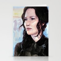 katniss Stationery Cards featuring Katniss Everdeen by Alina Rubanenko