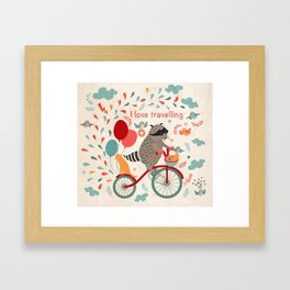 Cute raccoon on a bicycle with a cat, birds, balloons and drops. 'i love travel' text. Trip, journey Framed Art Print