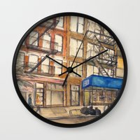 les mis Wall Clocks featuring LES by Yarden