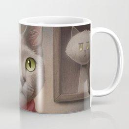 A cat holding a stuffed dog Coffee Mug