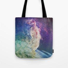 Astronaut dissolving through space Tote Bag