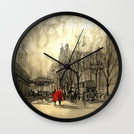 Couple in red walking on street of city Wall Clock