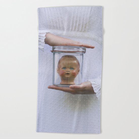 Doll in a jar Beach Towel