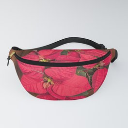 Red Christmas flower on brown wood Fanny Pack