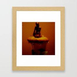 Lady on a stone Framed Art Print