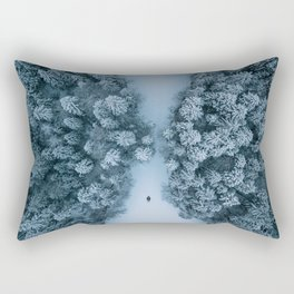 Man lying in the snow on a frozen lake in a winter forest - Landscape Photography Rectangular Pillow